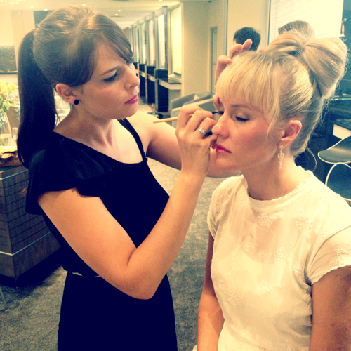 The lovely Brandslut getting her make-up done. Pink lips + liquid liner = perfection.